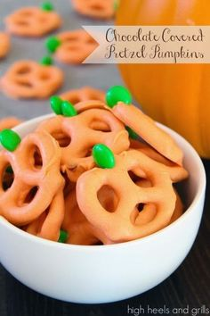 These chocolate covered pretzel pumpkins are just as yummy as they are cute! #recipe #Halloween #snack http://www.highheelsandgrills.com/2013/10/chocolate-covered-pretzel-pumpkins.html