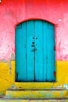 This door and the walls around it are an example of triadic color harmony. Red and greenish yellow are both two spaces from the teal blue color on the color wheel.