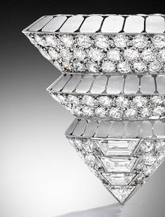 Platinum, 18 Karat White Gold and Diamond 'Pyramid' Brooch, Suzanne Belperron, France, 1932-1940. Estimate $20,000–30,000. Magnificent Jewels New York | 25 April 2017
