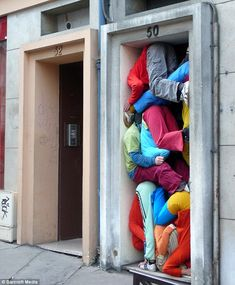 street performers tucked in a wall