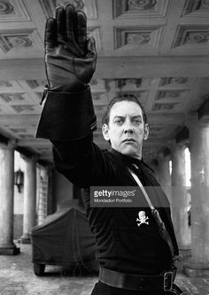 Donald Sutherland, wearing a fascist uniform to dress the part of Attila in the movie Novecento, gives a Roman salute. Parma, 1975.