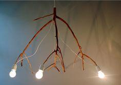 Tree branch lamp by Elin Riismark