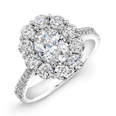 RingA - Cluster ring with Forevermark oval brilliant diamond accented with white diamond melee in 18kt white gold.