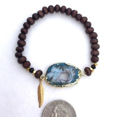 Host Pick🎉Gold Plated Druzy Stretch Bracelet Espresso wood round bead bracelet with gold plated nugget beads. Swarovski crystals and a Druzy pendant with Function and Fringe's signature gold plate feather charm. Each pendants has it's own color and uniqueness so these will vary slightly. Great worn alone or layered. Designed and made with 💕in California. Function & Fringe Jewelry Bracelets