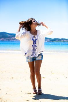 Try sporting a linen embroidered top like Alexandra of Lovely Pepa to keep cool and trendy at the beach. #styleblogger #summerfashion #linen