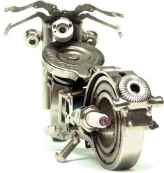Emerson Bianchin uses scrap pieces such as keys, bearings, and plumbing fixtures to create his miniature motorcycles. In describing his work, Emerson notes that a piece often begins with a single component, upon which he builds a matrix, eventually bringing the motorcycle to completion.