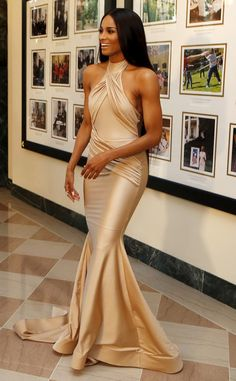 Ciara from The Best of the Red Carpet Seriously Ciara, teach us your ways! This silky champagne Walter Mendez creation.