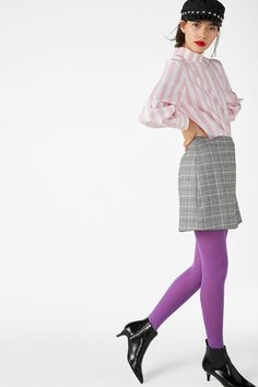 Got cravings for a checked n' fitted mini skirt? Well, check! Next step: Get out there and channel that inner boss.