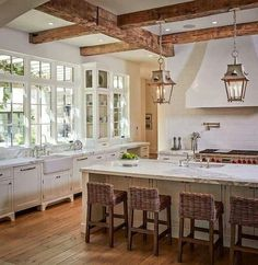 Would love windows like that in dining room. Beams & lights are a bonus!