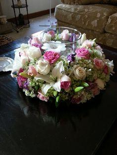 Bouquets centro de mesa bajo, tmb con jaula y velas y otros con pesera y vela flotante