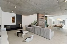Home Interior Design for Living Room with Grey Sofa and Black and white Table and Wall Decorations Home Interior Design Ideas with Sophisticated Concrete Interiors in the Czech Republic