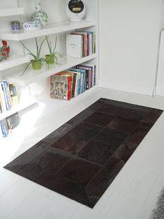 Tapijten en Huiden: Enkele realisatie's van patchwork tapijten