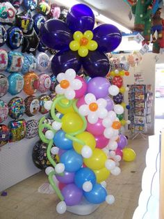 All about balloons, balloon sculptures, balloon bouquets, and balloon arches. Party ideas and LOTS of photos included!