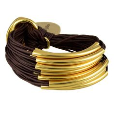Gillian Julius Multi Tube Bracelet, Gold | Chocolate Cord. Multi strand bracelet consisting of 20 waxed cotton cords. Each cord of bracelet features a gold tube.