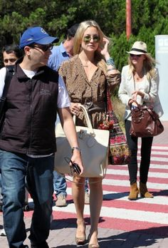 Kate Hudson, Naomi Watts and Liev Schreiber arrive at an airport in Venice.