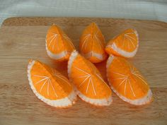 Vibrant, adorable little felt oranges add Velcro so they stick together