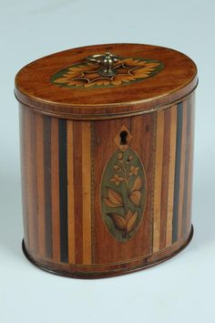 GEORGIAN MIXED WOOD INLAID OVAL TEA CADDY. Late 18th Century