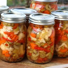 best italian chicago style giardiniera recipe pickled vegetables olives cauliflower celery carrots peppers hot mild canning muffuletta