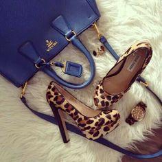 Blue prada. Leopard print handbag. Fur. Rose gold watch.
