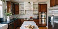 White cabinetry mixes with stained for a sharp contrast  - Trend Alert - Mixed Cabinet Finishes in the Kitchen