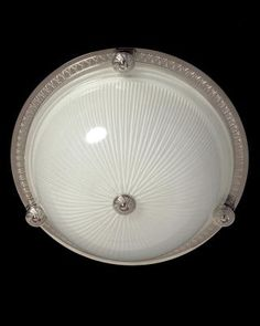 Marvin Alexander,Inc Nickeled bronze and ribbed glass flushmount with button, two lights.