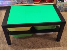 Lego table - Easy to do! Take IKEA Lack Coffee Table, glue on 6 10x10 green Lego base plates using Tacky Line Runner, then add 4 plastic tubs to store Legos