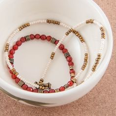 Short, delicate necklace made with faceted carnelian gemstone beads, glass seed beads, and brass beads. By Artigiana Designs - my original design. #necklace #jewelry #beaded #bohochic #carnelian #gemstone #seedbead #jewelryforsale #etsy #etsyshop #jewelrydesign