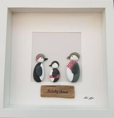 Pebble art picture Christmas penguin family of three