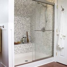 attic master bathroom and bedroom makeover from This Old House.  Great Shower idea for slanted walls.