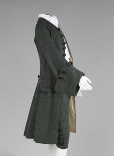 A frock coat was a looser cut and shorter dress coat that had turned down collars.
