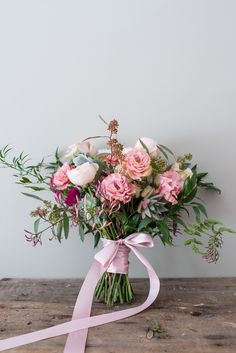Romantic garden style wedding bouquet with blush, peach and pink tones. Garden roses, ranunculus, succulents, lisianthus, seeded eucalyptus and jasmine vine. Created by Poppies and Twine Event and Wedding Florist, Yarmouth, Maine ~photo by Kristina O'Brien~