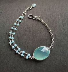 "Aqua Blue Chalcedony Bracelet by BitsofSilver; the perfect go to accessory for spring! This bracelet is handmade pairing Chalcedony rosary chain to a sterling silver rope chain for the look of modern simple styling.Extended links has been added to provide the maximum length of 73/4,"" minimum 7"". Only one available.($45)"