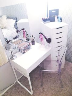 DIY White IKEA Vanity // Makeup Organization - Louis Ghost Chair dupe, Muji Acrylic 5 Drawer makeup organizer, white MICKE desk, beveled edge wall mirror, clear magazine holder hair station, lipstick organizer, white ALEX 9 drawers. #diyvanity #diymakeupv