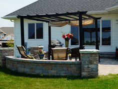A paver patio and pergola with a shade covering, ideal for hot summer days entertaining. The Vande Hey Company, Inc.