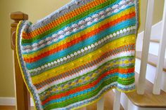 "IMG_0829 | Flickr - Photo Sharing!-                               Calling this my ""Happy Baby Blanket"" Multi-color stripes and various stitches-Worsted weight I Love this Yarn from Hobby Lobby (except the orange is RHSS Pumpkin)-Size I hook-100 stitches across x 81 rows + 4 border rows-36""x44"" completed size ( I crochet loose)"