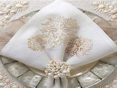 do white coral w/ seafoam napkins    Gorgeous coral napkins by Kim Seybert | Moyarta.com
