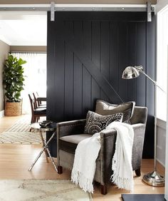 Black Shiplap Sliding Barn Door - CountryLiving.com ~ Great pin! For Oahu architectural design visit http://ownerbuiltdesign.com