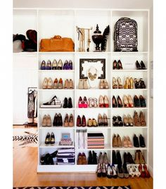 Use easy-to-find white bookshelves for your shoes in a dreamy closet design.