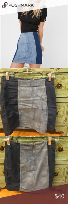 Free People two tone denim mini skirt Super cute and trendy denim skirt with back zipper and hook and eye closure! Unique piece. Only worn once. Bought it in another color I like better, so I'll let this one go to a home where it'll get the attention it deserves! Very stretchy. Could fit a size 2 Free People Skirts Mini