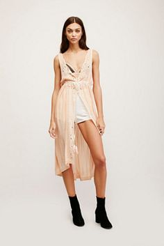 Riptide maxi by Free People. Effortless maxi top featuring tonal embroidery and cutout detail. Buttonup placket and drawstring...