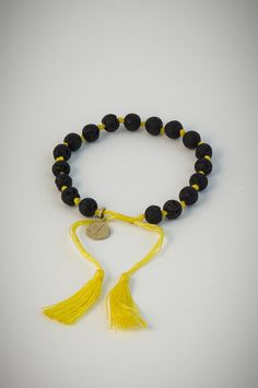 Yellow bracelet with black lucky stones. Lucky Stone, Black N Yellow, Tassel Necklace, Stones, Hats, Bracelets, Accessories, Jewelry, Bangle Bracelets