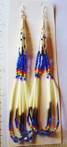 Porcupine earrings made with 11/o seed beads, 6mm Swarovski crystals. Amanda Decontie, 2012