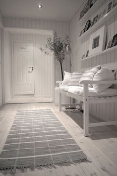 So cool, calm and collected . . . beautifully styled hallway in white with hints of grey.