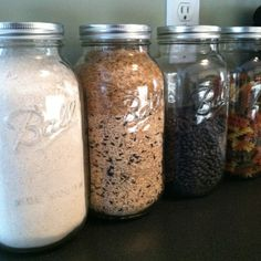 Our half-gallon Ball mason jars as canisters! From Ace Hardware ($12 for 6).