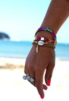 tan hand arm red nuon nail polish bracelets friendship colour colours summer sun beach ocean water