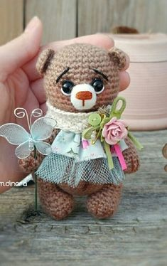 Crochet bear with a festive scarf! I love the pretty pastels and flowers on this amigurumi bear.