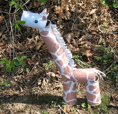 DIY Giraffe.  I could imagine this looking cute in a baby's room but then BOOM TODDLERHOOD and it dies a quick, painful death.