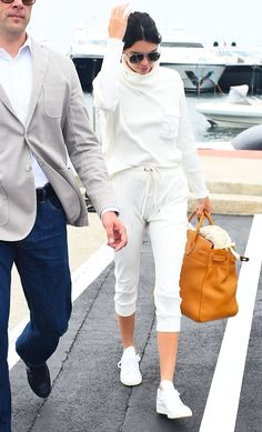Kendall Jenner was spotted at the airport leaving Cannes wearing a head-to-toe white outfit—see it here.