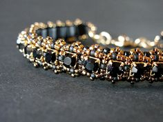 Cup Chain bracelet, black and gold tones.