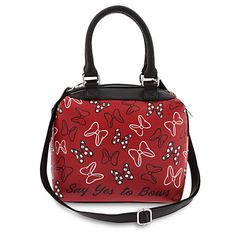 [Bow wow!]Carry a bag of bows everywhere you go with this Satchel Crossbody Bag. Minnie encourages you to ''Say Yes to Bows'' with this faux leather bag, featuring her trademark accessory, that has carry handles and a detachable shoulder strap.